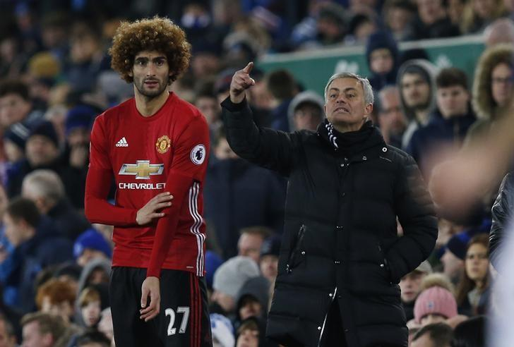 Football Soccer Britain - Everton v Manchester United - Premier League - Goodison Park - 4/12/16 Manchester United's Marouane Fellaini prepares to come on as a substitute as manager Jose Mourinho looks on Reuters / Andrew Yates Livepic