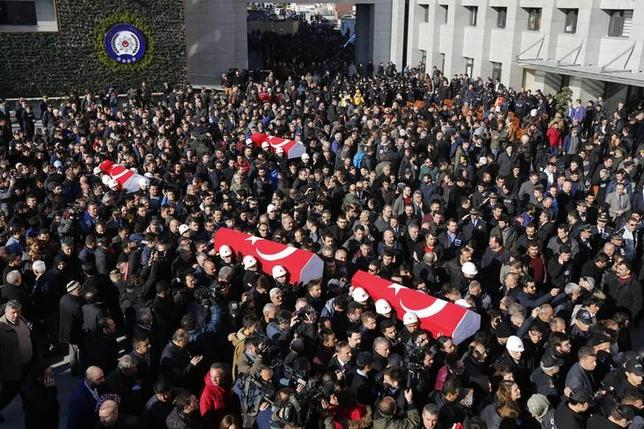 People carry the flag-draped coffins of police officers killed in Saturday's blasts in Istanbul, Turkey, December 11, 2016. REUTERS/Murad Sezer