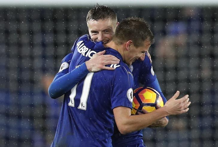 Football Soccer Britain - Leicester City v Manchester City - Premier League - King Power Stadium - 10/12/16 Leicester City's Jamie Vardy celebrates with Marc Albrighton whilst holding the match ball at the end of the match after scoring a hat-trick Reuters / Darren Staples Livepic
