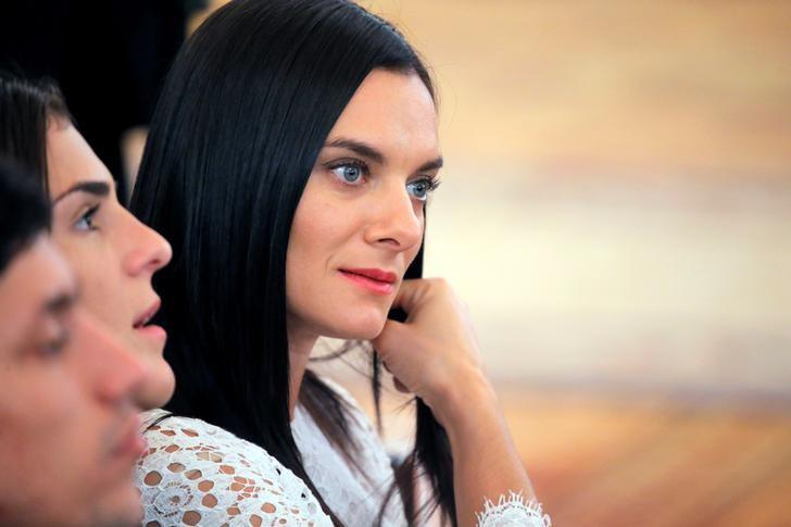 Russian pole vaulter Yelena Isinbayeva attends an awarding ceremony for Russian Olympic medallists returning home from the 2016 Rio Olympics at the Kremlin in Moscow, Russia, August 25, 2016. REUTERS/Maxim Shemetov/File Photo