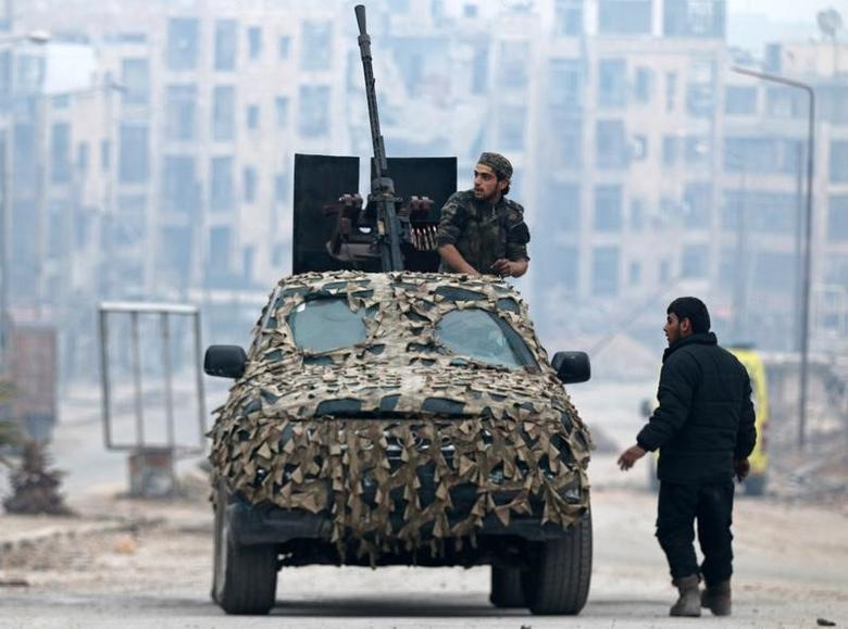 A Free Syrian Army fighter sits on a camouflaged vehicle mounted with a weapon in a rebel-held area of Aleppo, Syria December 12, 2016. REUTERS/Abdalrhman Ismail