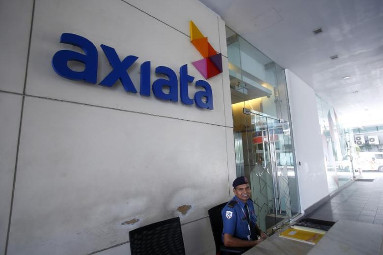A security officer guards in front of the Axiata headquarters buiding in Kuala Lumpur May 28, 2014. REUTERS/Samsul Said
