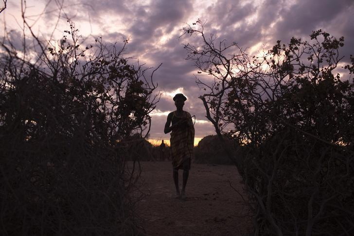 A Turkana man stand in the entrance of a cattle kraal at dawn in the disputed area of the Ilemi triangle in northwestern Kenya near the borders with Ethiopia and South Sudan October 15, 2013.  REUTERS/Siegfried Modola/Files