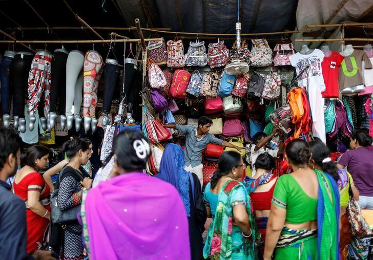 People shop for bags and clothes at roadside shops in a market in Mumbai, India June 13, 2016. REUTERS/Danish Siddiqui/Files
