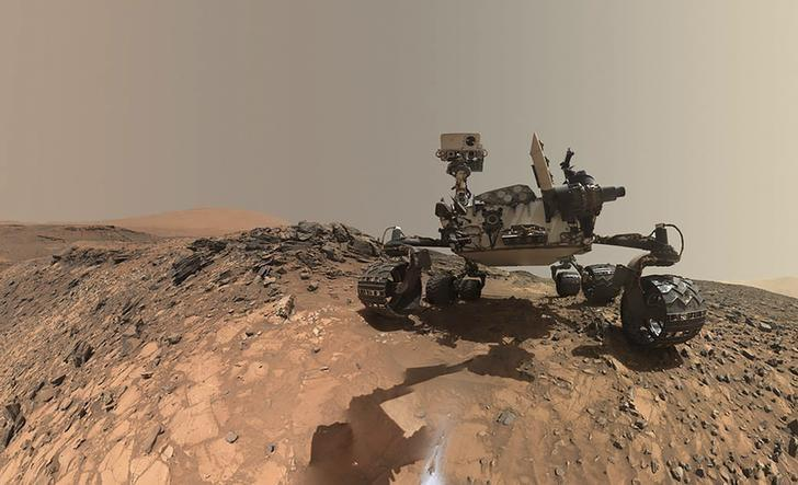 File Photo - NASA's Curiosity Mars rover is seen at the site from which it reached down to drill into a rock target called 'Buckskin' on lower Mount Sharp in this low-angle self-portrait taken August 5, 2015 and released August 19, 2015.   REUTERS/NASA/JPL-Caltech/MSSS/Handout