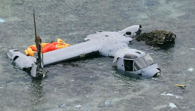 A wrecked U.S. Marine Corps MV-22 Osprey aircraft that crash-landed in the sea off Nago is seen in Okinawa Prefecture, Japan, in this photo taken by Kyodo December 14, 2016. Mandatory credit Kyodo/via REUTERS