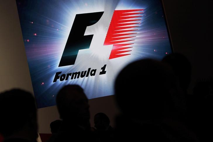 FILE PHOTO - Reporters are silhouetted by a screen showing a F1 logo during a news conference to announce a Formula One race in Mexico City July 23, 2014. REUTERS/Daniel Becerril