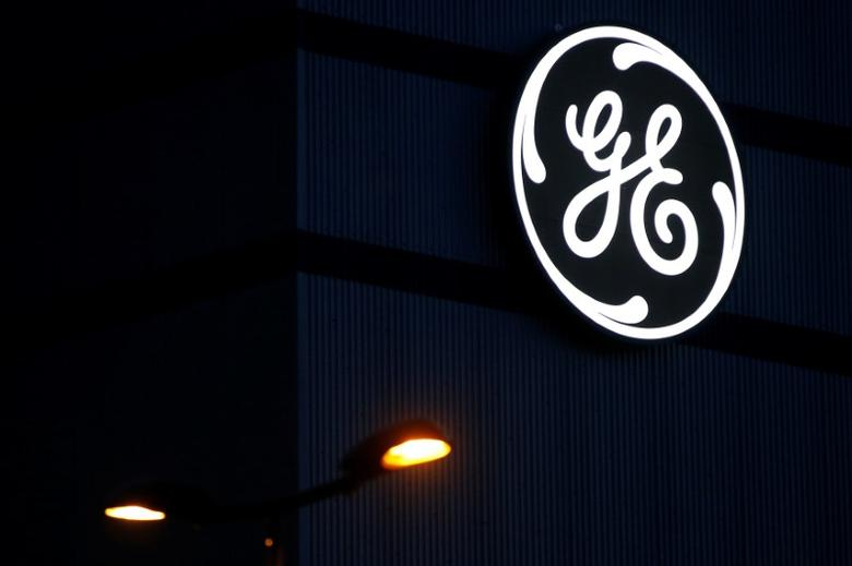The General Electric logo is pictured on the General Electric offshore wind turbine plant in Montoir-de-Bretagne, near Saint-Nazaire, western France, November 21, 2016. REUTERS/Stephane Mahe - RTSSOCQ