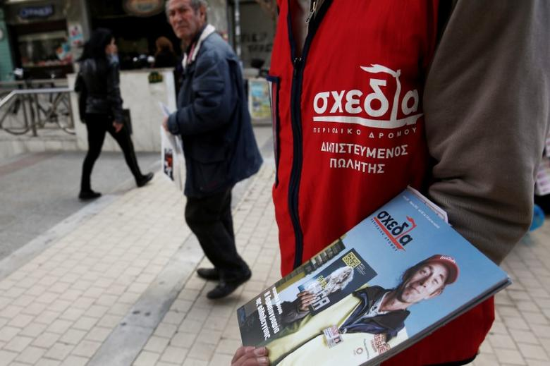 George Christou, 43, homeless and unemployed for the last two and half years, tries to sell a new magazine on a main street in Athens February 27, 2013.   REUTERS/Yorgos Karahalis/File Photo