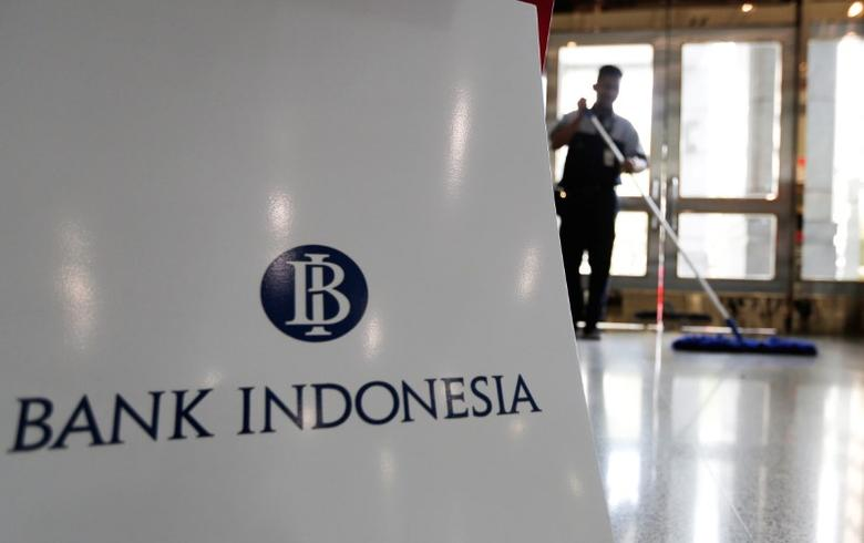 A man cleans floor behind the logo of Bank Indonesia at the bank's headquarters in Jakarta, November 17, 2016. REUTERS/Beawiharta