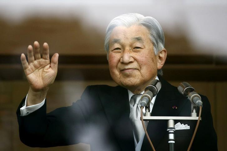 Japan's Emperor Akihito waves to well-wishers who gathered at the Imperial Palace to mark his 82nd birthday in Tokyo, Japan, December 23, 2015. REUTERS/Thomas Peter/File Photo