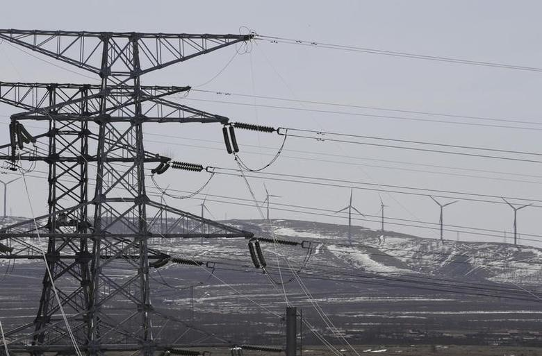 Power lines and wind turbines are pictured at a wind and solar energy storage and transmission power station of State Grid Corporation of China, in Zhangjiakou of Hebei province, China, March 18, 2016. REUTERS/Jason Lee