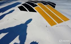 Логотип Роснефти на заводе компании на Приобском месторождении под Нефтеюганском 4 августа 2016 года. Министерство финансов России в пятницу отчиталось о получении средств от приватизации пакета государственной нефтекомпании Роснефть. REUTERS/Sergei Karpukhin