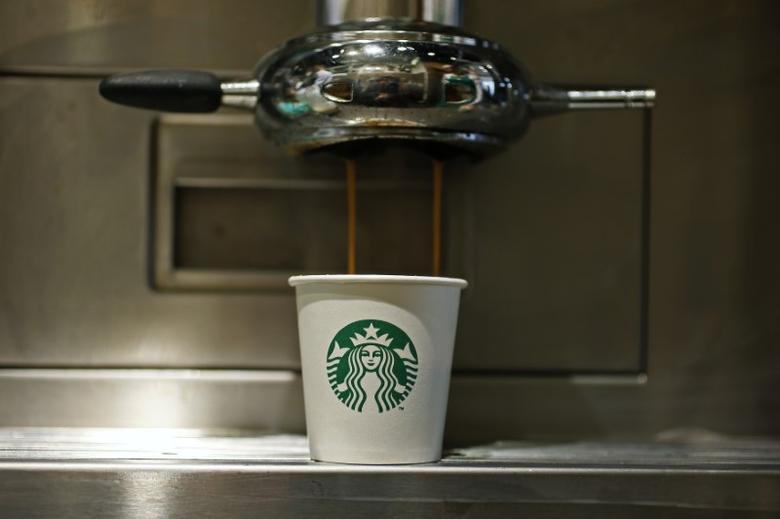 A paper cup is seen in Starbucks' Vigo Street branch in Mayfair, central London January 11, 2013.  REUTERS/Stefan Wermuth