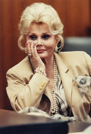 Actress Zsa Zsa Gabor listens in court in Beverly Hills, California, U.S. in this May 1, 1990 file photo.  REUTERS/Pool/File Photo