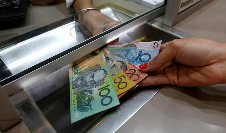 Australian dollar denominations shown in a photo illustration at a currency exchange in Sydney, Australia, June 7, 2016. REUTERS/Jason Reed/File Photo