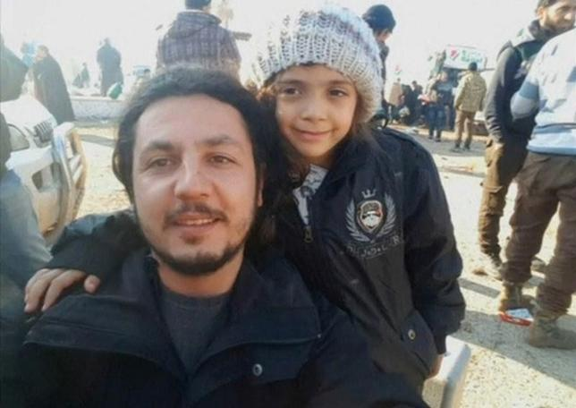 A still image taken on December 19, 2016 from a handout video posted by IHH, shows a still photograph of Syrian girl who tweeted from Aleppo, Bana Alabed, posing with IHH aid worker Burak Karacaoglu in al-Rashideen, Syria. IHH/Handout via Reuters TV