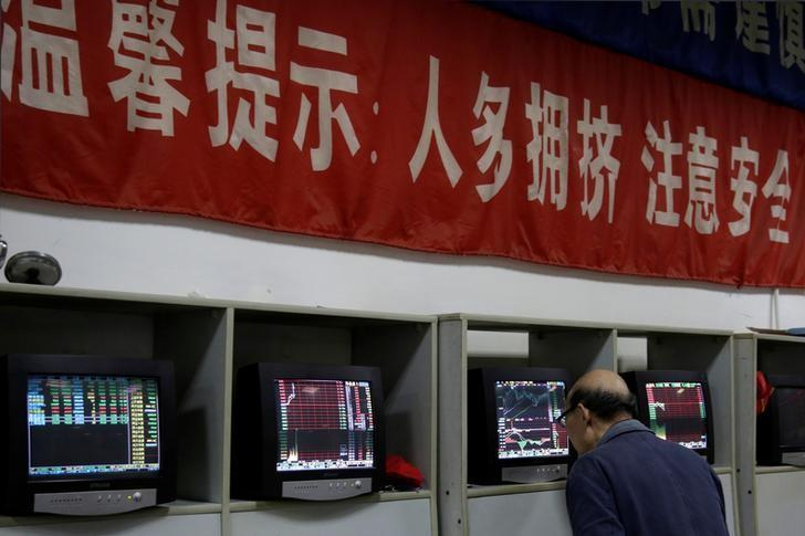 An investor looks at a screen showing stock information at a brokerage house in Shanghai, China November 9, 2016. REUTERS/Aly Song/Files