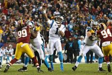 Dec 19, 2016; Landover, MD, USA; Carolina Panthers quarterback Cam Newton (1) throws the ball as Washington Redskins defensive end Ricky Jean Francois (99) defends in the third quarter at FedEx Field. The Panthers won 26-15. Mandatory Credit: Geoff Burke-USA TODAY Sports