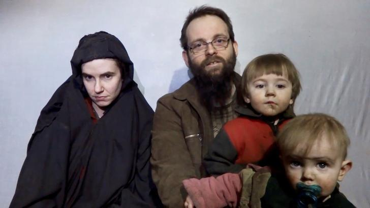 A still image from a video posted by the Taliban on social media on December 19, 2016 shows American Caitlan Coleman (L) speaking next to her Canadian husband Joshua Boyle and their two sons. Taliban/Social media via Reuters