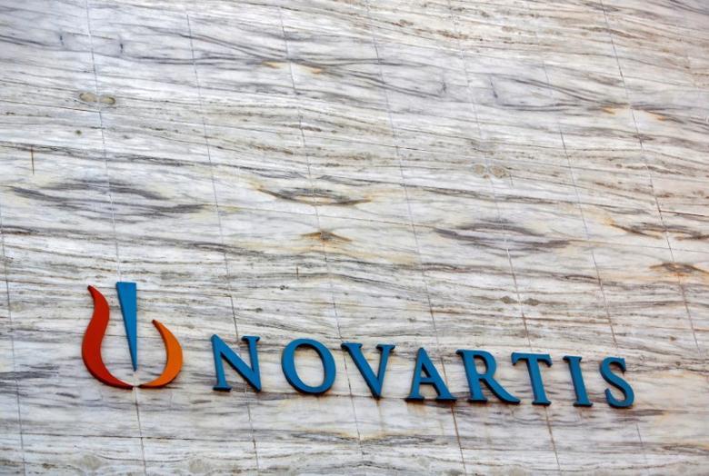 A Novartis logo is pictured on its headquarters building in Mumbai April 1, 2013.  REUTERS/Vivek Prakash/File Photo
