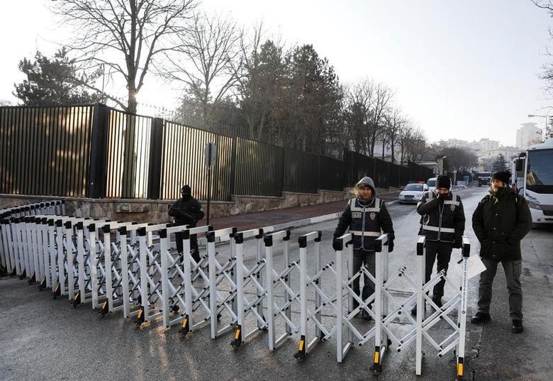Turkish police stand guard outisde the Russian Embassy in Ankara, Turkey, December 20, 2016. REUTERS/Umit Bektas