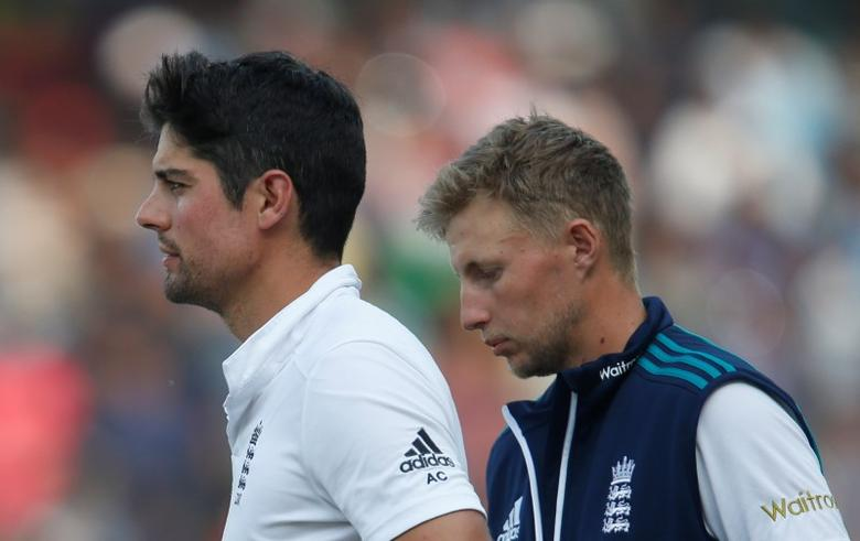 Cricket - India v England - Fifth Test cricket match - M A Chidambaram Stadium, Chennai, India - 20/12/16. England's captain Alastair Cook (L) and his team mate Joe Root stand in field after losing the test series. REUTERS/Danish Siddiqui