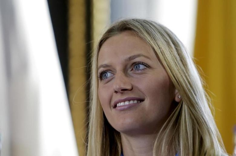 FILE PHOTO: Czech Republic's Petra Kvitova smiles during the draw for the Fed Cup final in Prague November 13, 2015. REUTERS/David W Cerny/File Photo