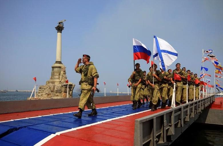 Russian marines parade during the Navy Day celebrations in Sevastopol, Crimea, July 31, 2016.  REUTERS/Pavel Rebrov