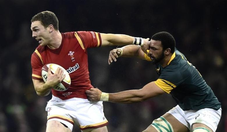 Wales v South Africa - Principality Stadium, Cardiff, Wales - 26/11/16 Wales' George North is tackled by South Africa's Uzair Cassiem  Reuters / Rebecca Naden Livepic