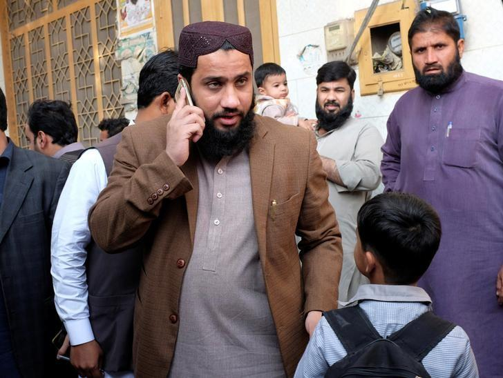 Masroor Nawaz Jhangvi, a Muslim cleric whose father was one of Pakistan's most infamous sectarian figures, uses his mobile phone while meeting residents in Jhang December 16, 2016. Picture taken December 16, 2016.  REUTERS/Drazen Jorgic