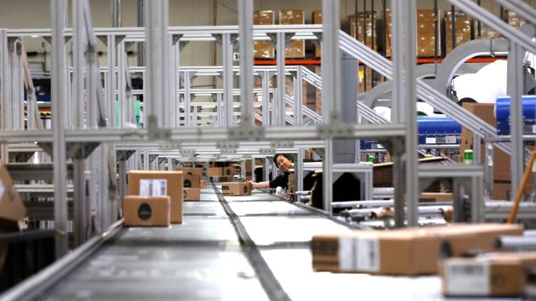 An employee pushes a box on a conveyor belt at the Newegg warehouse on Cyber Monday in City of Industry, California, U.S. November 28, 2016.  REUTERS/Mario Anzuoni