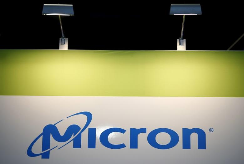 The logo of U.S. memory chip maker MicronTechnology is pictured at their booth at an industrial fair in Frankfurt, Germany,  July 14, 2015. REUTERS/Kai Pfaffenbach