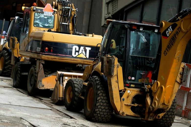Caterpillar machines are seen at a construction site in New York City, U.S., October 17, 2016.  REUTERS/Brendan McDermid  - RTX2P8UN