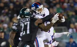 Dec 22, 2016; Philadelphia, PA, USA; New York Giants wide receiver Odell Beckham (13) makes a reception past Philadelphia Eagles strong safety Malcolm Jenkins (27) during the fourth quarter at Lincoln Financial Field. The Philadelphia Eagles won 24-19. Mandatory Credit: Bill Streicher-USA TODAY Sports