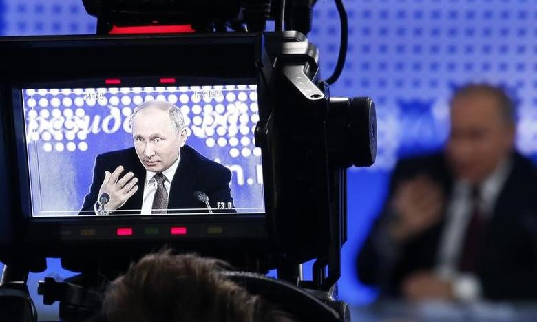 Russian President Vladimir Putin is seen on the viewfinder of a camera during his annual end-of-year news conference in Moscow, Russia, December 23, 2016.  REUTERS/Sergei Karpukhin