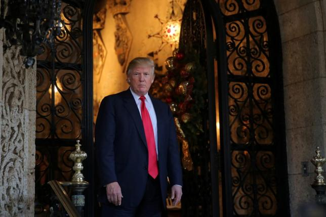 U.S. President-elect Donald Trump pauses as he talks to members of the media after a meeting with Pentagon officials at Mar-a-Lago estate in Palm Beach, Florida, U.S., December 21, 2016. REUTERS/Carlos Barria