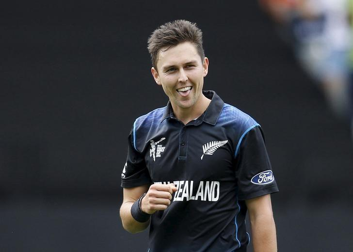 New Zealand's Trent Boult reacts after catching out South Africa's Quentin de Kock during their Cricket World Cup semi final in Auckland, March 24, 2015.  REUTERS/Nigel Marple/Files
