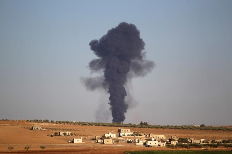 Smoke rises from al-Bab city, northern Aleppo province, Syria October 26, 2016. REUTERS/Khalil Ashawi