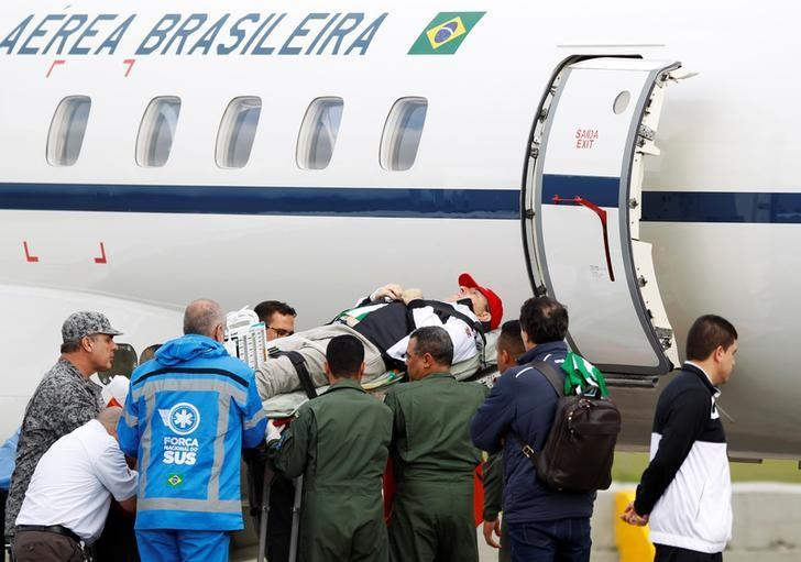 Brazilian radio journalist Rafael Henzel is being loaded into a plane of Brazilian's Air Force for his return to Brazil, after he survived a plane crash with Brazilian soccer team Chapecoense aboard, in Rionegro, Colombia, December 13, 2016. REUTERS/Fredy Builes/Files