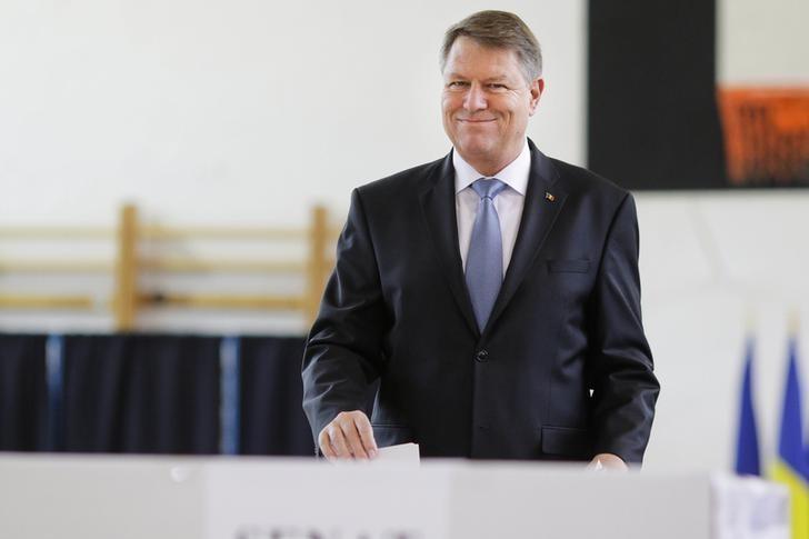 Romania's President Klaus Iohannis smiles while casting his ballot for a parliamentary election in Bucharest, Romania, December 11, 2016.    Inquam Photos/Octav Ganea/via REUTERS/Files