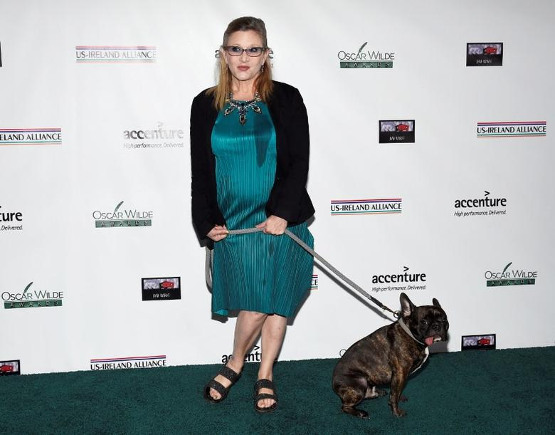 FILE PHOTO: Honoree Carrie Fisher and her dog Gary pose at the Oscar Wilde Awards at director J.J. Abrams' Bad Robot production company in Santa Monica, California February 19,  2015.  REUTERS/Kevork Djansezian/File Photo