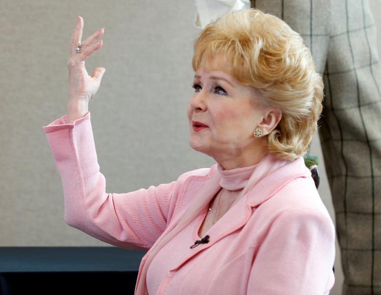FILE PHOTO: Actress Debbie Reynolds gestures as she is interviewed at a preview of her vast Hollywood costume and prop collection in Beverly Hills June 6, 2011.  REUTERS/Fred Prouser/File Photo