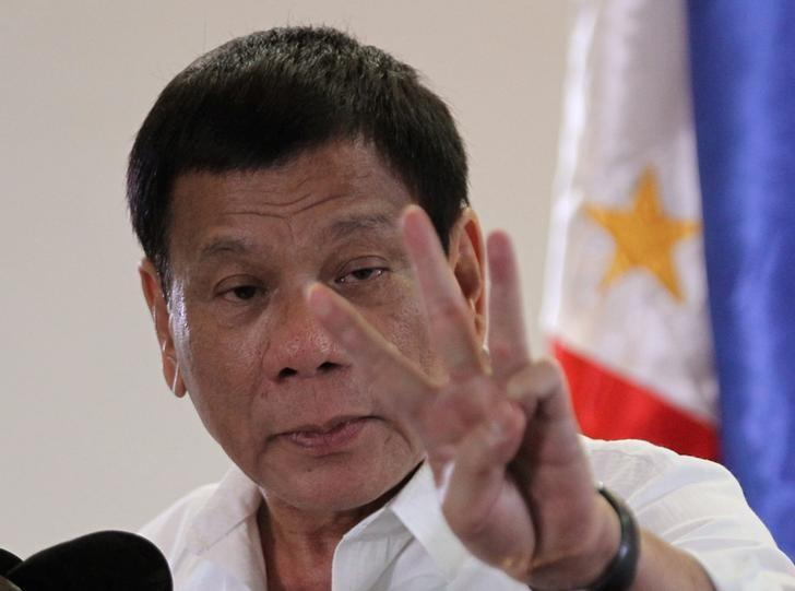 FILE PHOTO: Philippine President Rodrigo Duterte speaks upon his arrival at Davao International Airport in Davao city, Philippines, after returning from an APEC summit meeting in Peru, November 23, 2016. REUTERS/Lean Daval Jr/File Photo