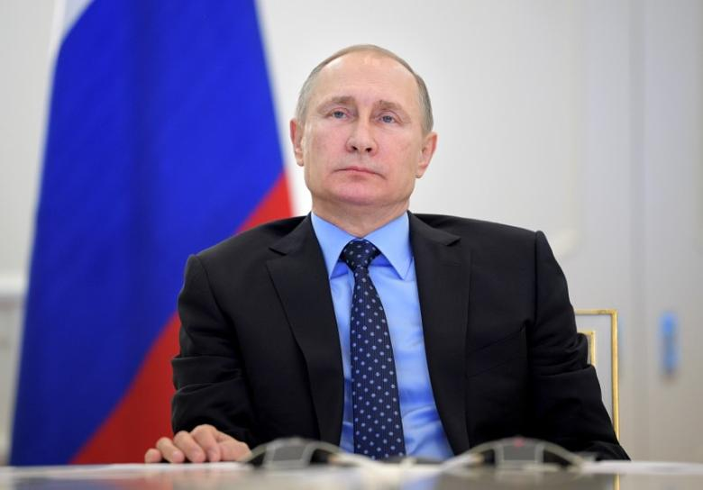 Russian President Vladimir Putin takes part in a video link, dedicated to the start of natural gas supplying from mainland Russia to Crimea, in Moscow, Russia, December 27, 2016. Sputnik/Alexei Druzhinin/Kremlin via REUTERS