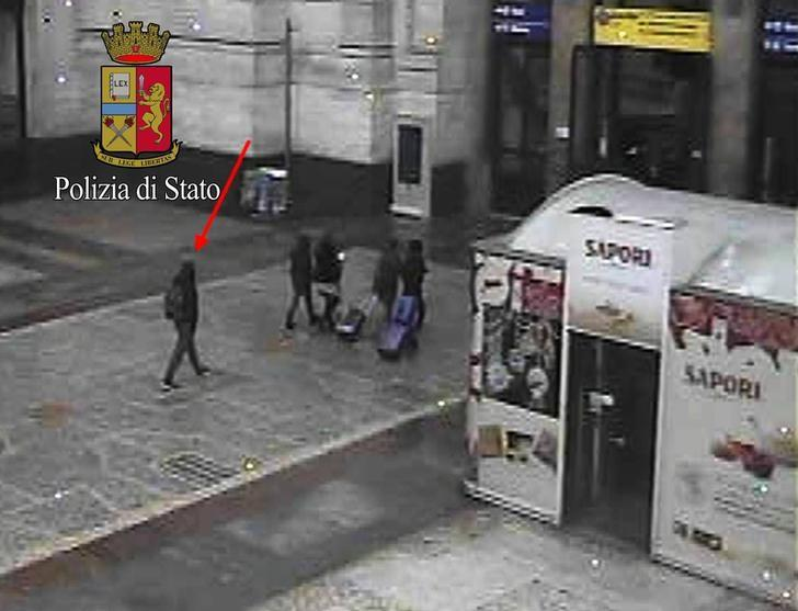 Anis Amri (L), the Tunisian suspect of the Berlin Christmas market attack, is seen in this photo taken from security cameras at the Milan Central Train Station in downtown Milan, Italy December 23, 2016, hours before he was shot dead after pulling a gun on police during a routine check.  Photo released by Italian Police.Polizia di Stato Press Office/Handout via REUTERS