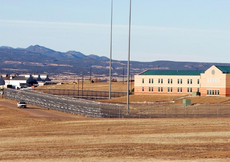 FILE PHOTO --  A patrol vehicle is seen along the fencing at the Federal Correctional Complex, including the Administrative Maximum Penitentiary or ''Supermax'' prison, in Florence, Colorado February 21,2007.  Supermax houses terrorists and the most violent inmates. REUTERS/Rick Wilking/File Photo