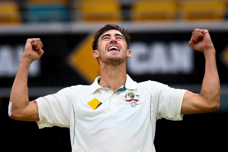 Australian bowler Mitchell Starc celebrates the wicket of New Zealand batsman Tom Latham, during the first cricket test match between Australia and New Zealand in Brisbane, November 8, 2015. REUTERS/Patrick Hamilton  Picture Supplied by Action Images