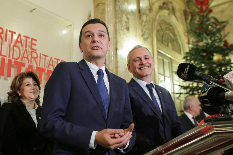 Sorin Grindeanu (C) gestures while answering a question during a press conference held alongside Romania's Social Democrat party (PSD) leader, Liviu Dragnea (R), in Bucharest, Romania December 28, 2016. Inquam Photos/Octav Ganea/via REUTERS