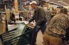 """Shoppers rush to grab items inside a Cabela's store on the shopping day dubbed """"Black Friday"""" in Fort Worth, Texas November 27, 2009. REUTERS/Jessica Rinaldi"""